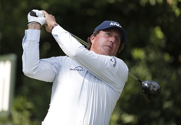 This photo taken May 10, 2018, shows Phil Mickelson hitting from the 11th tee during the first round of the Players Championship golf tournament in Ponte Vedra Beach, Fla. Mickelson doesn't need to be reminded that this is his 27th appearance in the U.S. Open, more than any of the 156 players at Shinnecock Hills and and needs this title to complete the career Grand Slam. He wouldn't want to be reminded that 65 players, including the last four major champions, were not even born when Mickelson was low amateur in his first U.S. Open in 1990 at Medinah. (Lynne Sladky/AP, File)