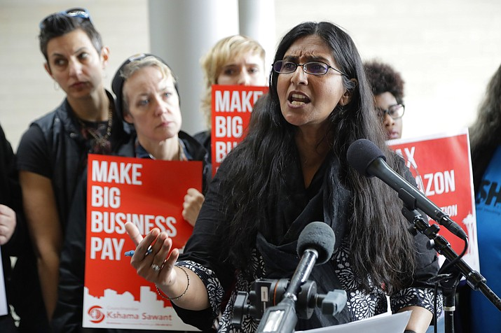 Seattle City Council member Kshama Sawant speaks, Tuesday, June 12, 2018, at City Hall in Seattle. Sawant and other members of the Council were expected to vote Tuesday on whether or not to repeal a tax on large companies such as Amazon and Starbucks that was intended to combat a growing homelessness crisis. (AP Photo/Ted S. Warren)