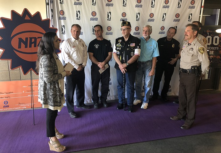 Northern Arizona Suns Director of Business Operations Ashley Stovall, left, talks with members of the law enforcement, first responders and military community Tuesday, June 12, 2018, at the Prescott Valley Event Center. The Suns donated $7.520 in raised funds from the Salute to Heroes Night last season. (NAZ Suns/Courtesy)