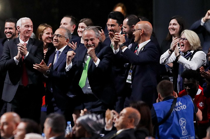 Delegates of Canada, Mexico and the United States celebrate after winning a joint bid to host the 2026 World Cup at the FIFA congress in Moscow, Russia, Wednesday, June 13, 2018. Standing on front row from left: Steve Reed, president of the Canadian Soccer Association, Carlos Cordeiro, U.S. soccer president and Decio de Maria, President of the Football Association of Mexico. (Pavel Golovkin/AP)