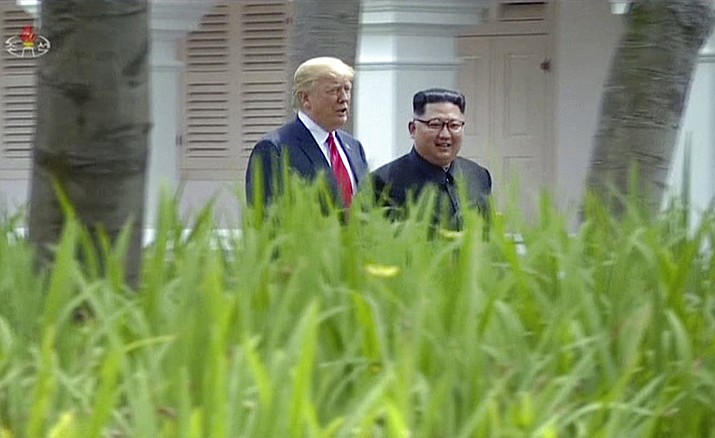 "In this image made from video released by KRT on June 14, 2018, shows North Korean leader Kim Jong Un, right, walking with U.S. President Donald Trump in the garden during their summit in Singapore, June 12, 2018. Through the state-run media's edited footage of the summit that aired in their country Thursday, North Koreans are getting a new look at U.S. President Donald Trump now that his summit with leader Kim Jong Un is safely over and it's a far cry from the ""dotard"" label Pyongyang slapped on him last year. (KRT via AP Video)"