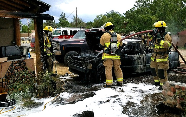 The older model Mazda pickup truck is a total loss and damage estimates to the two homes is $6,000. Photo courtesy City of Cottonwood