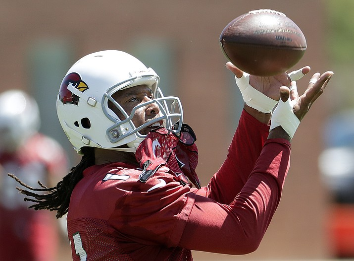 Arizona Cardinals' Larry Fitzgerald (11) makes a catch during practice at the NFL football team's training camp Thursday, June 7, 2018, in Tempe. (Matt York/AP)