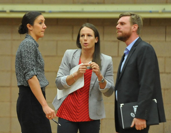 Travis Stedman, right, talks with former Embry-Riddle head coach Becky Burke, middle, and Rachel Galligan, during a game against Benedictine-Mesa on Dec. 7, 2017, in Prescott. Stedman was named the next head boys basketball coach at Prescott on Thursday, June 14, 2018, after longtime coach Adam Neely resigned. (Les Stukenberg/Courier, File)