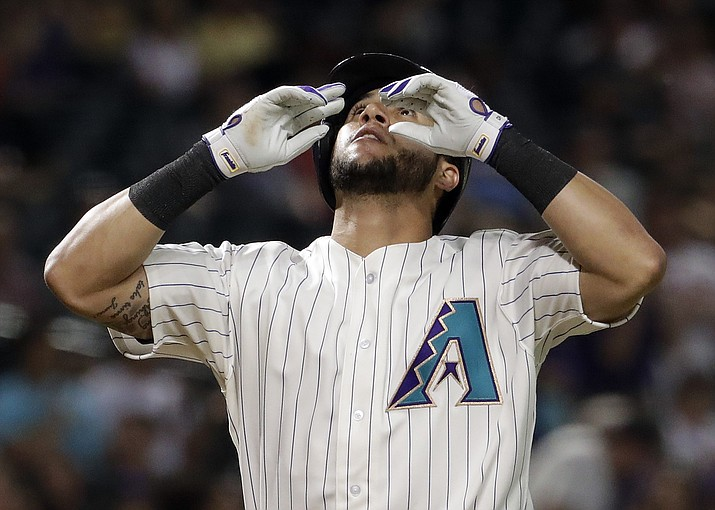 Arizona Diamondbacks' David Peralta celebrates his solo home run against the New York Mets during the eighth inning of a baseball game, Thursday, June 14, 2018, in Phoenix. (Matt York/AP)