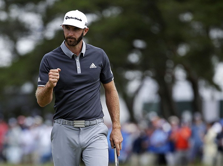 Dustin Johnson reacts after making a putt for birdie on the fourth green during the second round of the U.S. Open Golf Championship, Friday, June 15, 2018, in Southampton, N.Y. (Seth Wenig/AP)