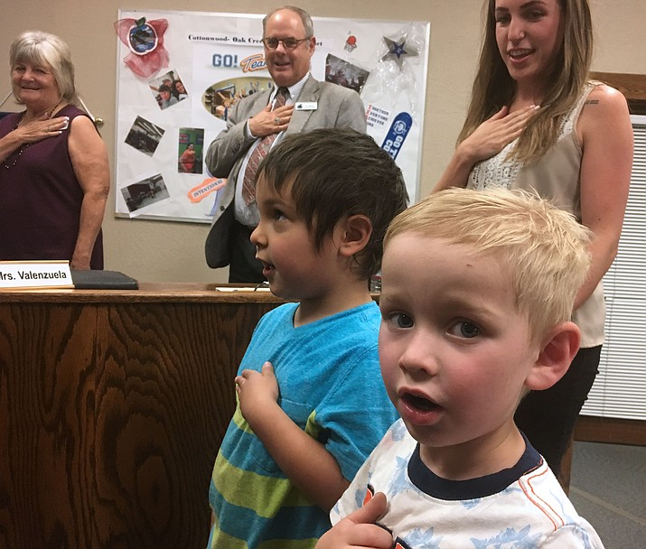 Students in the Bright Bears pre-school program lead the Pledge of Allegiance during Cottonwood-Oak Creek School District's June 14 board meeting. The board voted 5-to-0 to accept the district's proposed budget, which calls for a 12-percent pay increase for teachers. A 9-percent increase for support staff and a 6-percent increase for administration that has not already signed a contract for 2018-2019 was also offered. VVN/Bill Helm