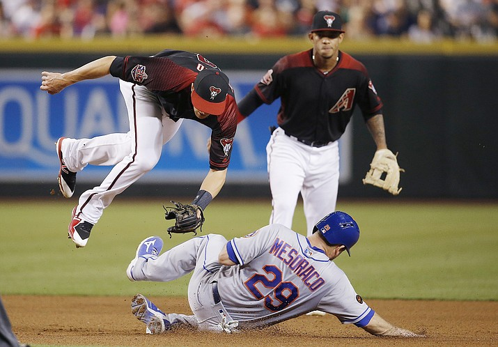 Mets' Devin Mesoraco (29) upends Diamondbacks shortstop Nick Ahmed, left, after Mesoraco was forced out at second base as Ketel Marte, back right, watches during the fourth inning Saturday, June 16, 2018, in Phoenix. (Ross D. Franklin/AP)