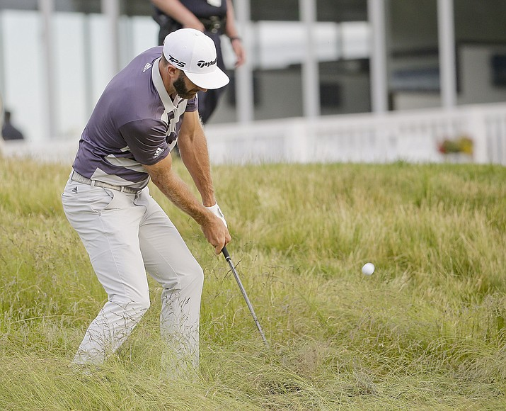 Dustin Johnson hits out of the rough on the 15th hole during the third round of the U.S. Open Golf Championship, Saturday, June 16, 2018, in Southampton, N.Y. (Seth Wenig/AP)