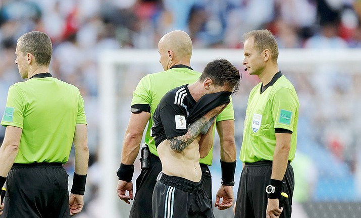 Argentina s Lionel Messi covers his face at the end of the group D match  between Argentina 944d0e76b1d18