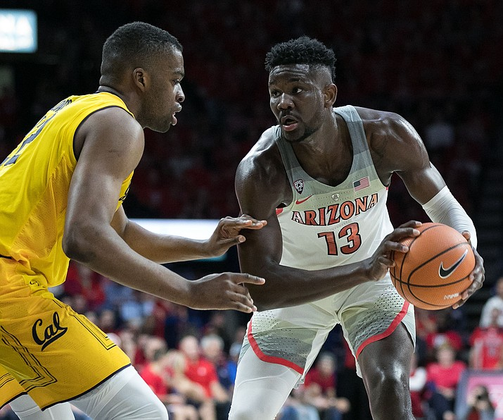Deandre Ayton, UA's one-and-done athlete, looks to score past Cal's Kingsley Okoroh during the Arizona-Cal game on Saturday, March 3 in McKale Center. (Photo by: © Simon Asher / The Daily Wildcat)