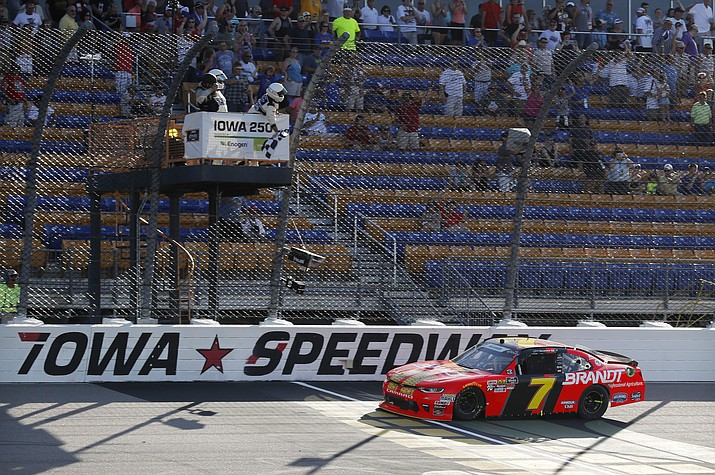 Justin Allgaier crosses the finish line while winning the NASCAR Xfinity Series auto race, Sunday, June 17, 2018, at Iowa Speedway in Newton, Iowa. (Charlie Neibergall/AP Photo)