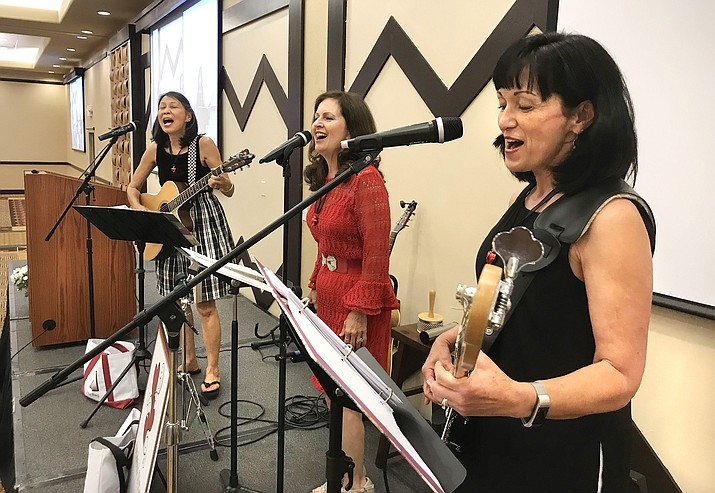 The Kindred Sisters band performs during the People Who Care gala at the Prescott Resort Saturday, June 16, 2018. From left, Regina Younger, Gena Soiled and Julie Huck. (Richard Haddad/WNI)