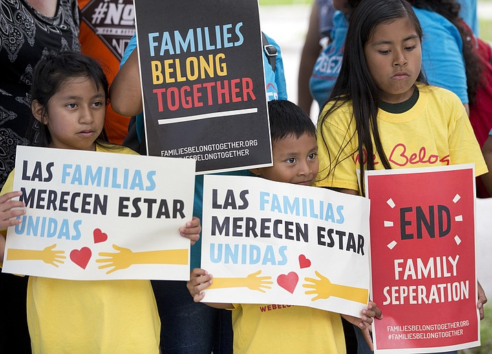 Children are pictured on June 1, 2018, holding signs during a demonstration in front of the Immigration and Customs Enforcement offices in Miramar, Florida. The Trump administration's move to separate immigrant parents from their children on the U.S.-Mexico border has turned into a crisis in recent weeks, drawing denunciation from the United Nations, Roman Catholic bishops and countless humanitarian groups. (Wilfredo Lee/AP, file)