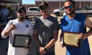 From left: Nevada resident Chris Madden, tournament director Tanner Miller and Josh Holstrom show plaques Madden and Holstrom won for taking first place in Stripe R Rama 27. This is the second year in a row that this Nevada team has taken the top spot in the Stripe R Rama tournament. (Photo special to the Daily Miner)