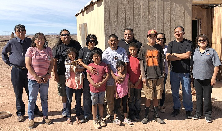 On May 31, Big Navajo Energy LLC installed a solar generator for the Mejia family. Left: Council Delegate Walter Phelps, Cameron Chapter President Milton Tso, Yolinda and Jesus Mejia and family, Big Navajo Energy CEO Dory Peters, NTEC Community Affair Coordinator Melissa Kelly and NTEC Communications Director Erny Zah. (Submitted photo)