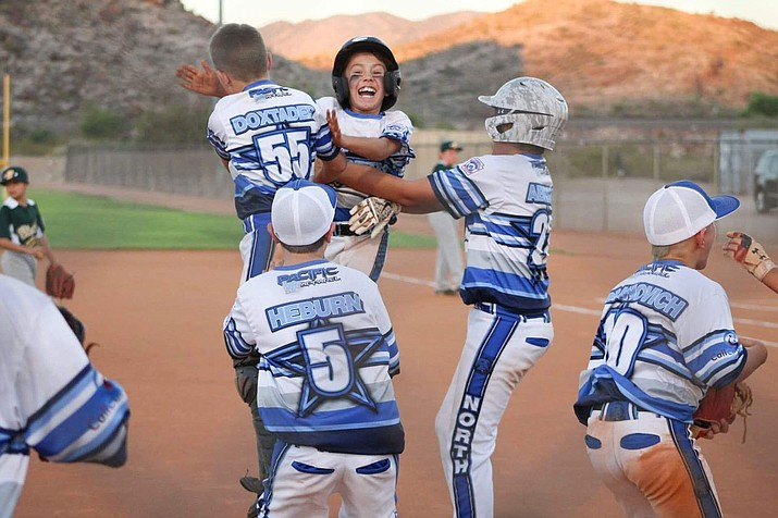 The Kingman North 9-11 All Stars celebrate on the field after defeating Blythe, 12-2, to advance in the District 9 Tournament at Southside Park. (Courtesy of Jakki Paulson)