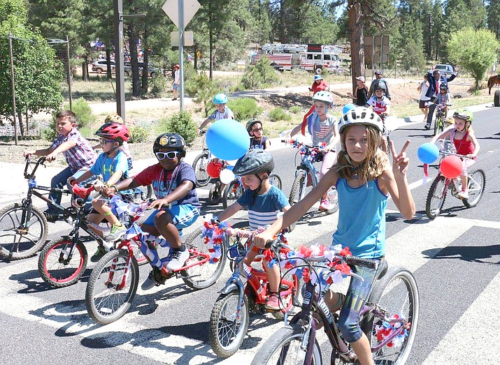 Local youth line up for the decorated bike parade at Tusayan's 2017 Fourth of July celebration. (Photo/Laura Chastain)