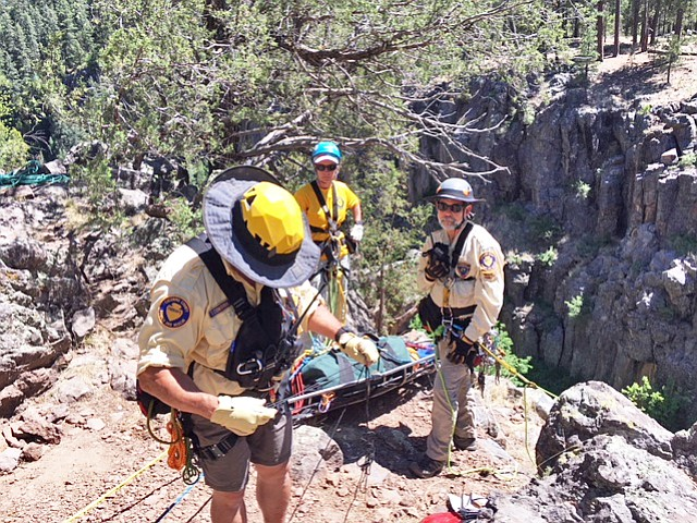 Coconino County Search and Rescue,  Williams Fire Department, DPS heli-rescuers, lifeline EMTs and Coconino County deputies work to evacuate an injured climber in Sycamore Canyon June 10. (Williams Fire Department)