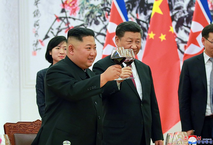 "In this June 19, 2018, photo provided on June 20, 2018, by the North Korean government, North Korean leader Kim Jong Un, left, toasts with Chinese President Xi Jinping, at the Great Hall of the People in Beijing, China. Korean language watermark on image as provided by source reads: ""KCNA"" which is the abbreviation for Korean Central News Agency. (Korean Central News Agency/Korea News Service via AP)"