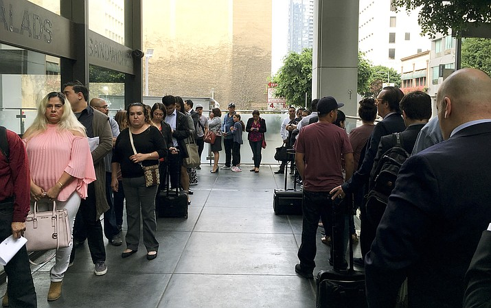 Immigrants awaiting deportation hearings, line up outside the building that houses the immigration courts in Los Angeles on June 19, 2018. (Amy Taxin/AP Photo)