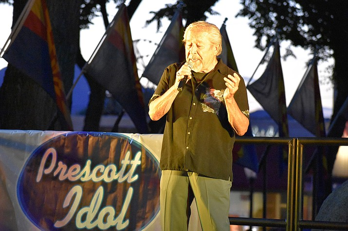 "To the delight of a lively audience gathered in the courthouse plaza, Prescott Idol contestant Al Slade sings and dances to the classic Engelbert Humperdinck song, ""Quando Quando Quando,"" on June 14, 2018. The Idol competition is part of the 2018 Summer Concert & Movie Series being offered in downtown Prescott through the end of August. (Richard Haddad/WNI)"