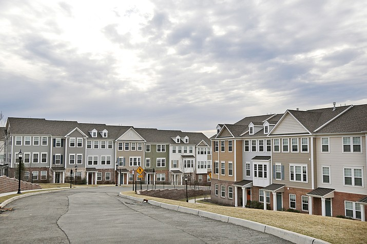 New townhouses await tenants, but a strong job market can actually be a curse for would-be homebuyers. With more people drawing paychecks and able to afford a home, demand has intensified. Yet, the number of homes listed for sale is flirting with historic lows. (Seth Wenig/AP, file)
