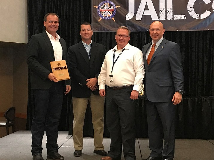 Chief Deputy David Rhodes (left), Jail Commander Jeff Newnum, Jail Administration Lt. Brian Silvernale and Tate MCotter, National Institute for Jail Operations (NIJO) executive director, at the NIJO conference in Scottsdale on June 7, 2018. (Yavapai County Sheriff's Office/Courtesy)