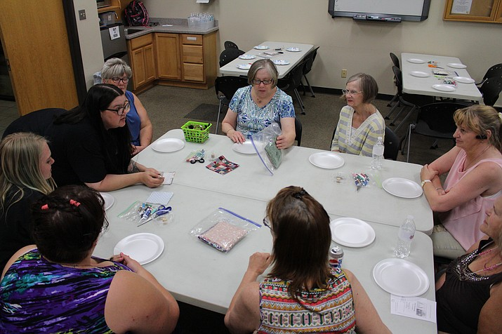 Adult participants in Mohave County Library's Summer Reading Program work on a craft project Wednesday at the Kingman Library branch. The program continues through July 14. (Photo by Hubble Ray Smith/Daily Miner)