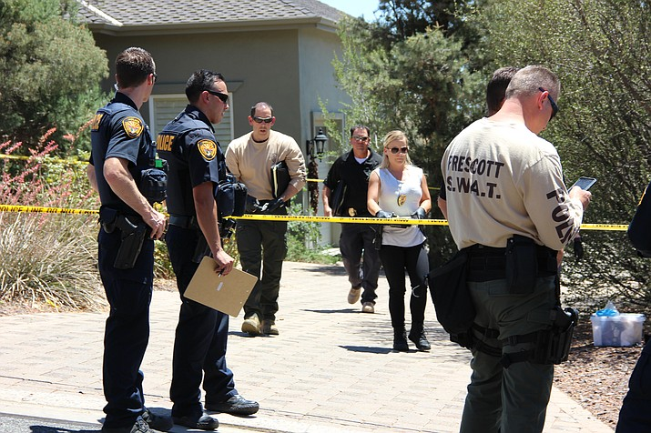 Investigators with the Prescott Police Department exit a home in the neighborhood of South View in Prescott off of Williamson Valley Road early Thursday afternoon, June 21, soon after the department discovered a dead man in the home during a welfare check. They believe the man was murdered. Photo by Max Efrein.