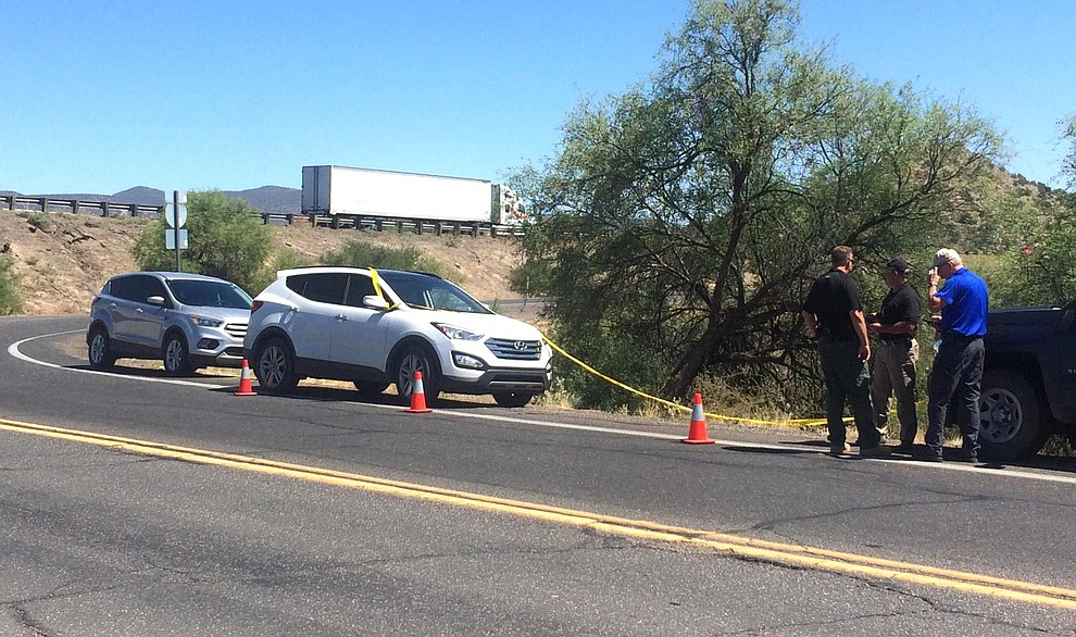 Officers secure an area with yellow tape near the Arizona 179-Interstate 17 exit in the search for a homicide suspect from an incident in the Prescott area on Thursday, June 21, 2018. (Vyto Starinskas, Verde Independent)
