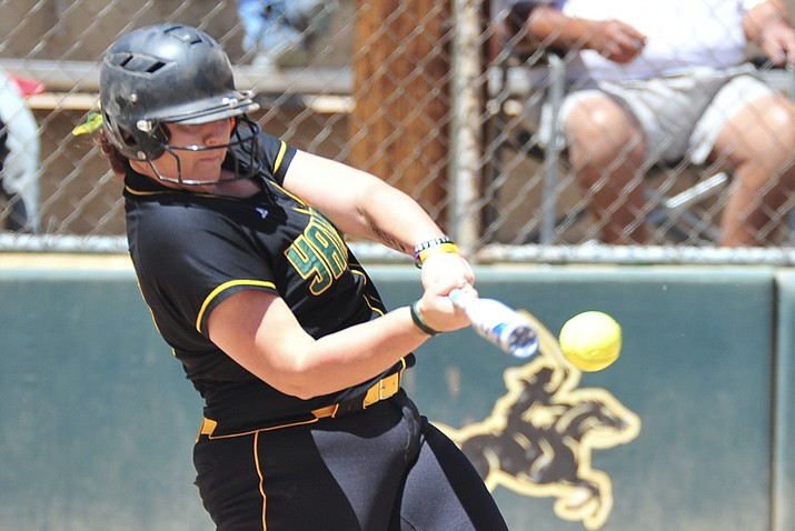 Yavapai College catcher Jaydee Boursaw makes contact as the Roughriders host Central Arizona on May 4, 2018. Boursaw was named the 2018 NJCAA National Player of the Year on Thursday, June 21, 2018, for her efforts on the field this past season. (Les Stukenberg/Courier, File)