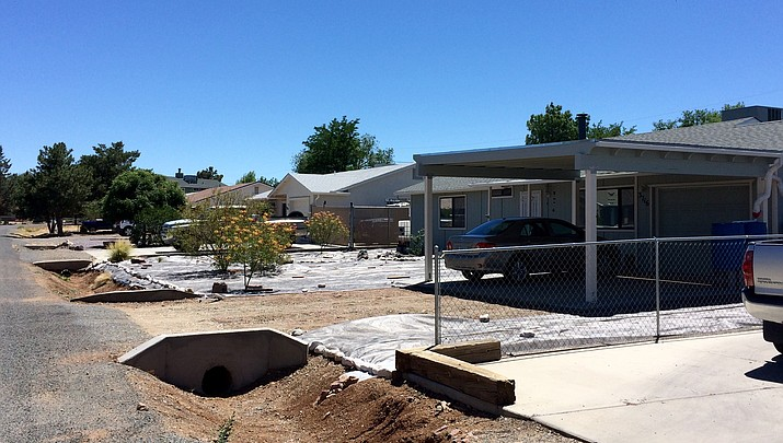 Neighbor wants town regulations relaxed for adding carport