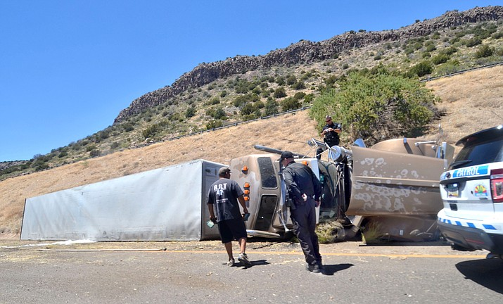 The driver and passenger of a runaway semi-trailer truck jumped from their vehicle on Interstate 17 in Camp Verde Wednesday, June 20, 2018. The passenger, 22-year-old Johnathon Hardaway of Indianapolis, was killed. The 25-year-old driver, also from Indianapolis was flown to a local hospital for treatment. The truck continued northbound for approximately a quarter mile and crashed. (Vyto Starinskas, Verde Independent)