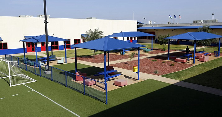 In this 2014, file photo, a courtyard is seen at the Karnes County Residential Center in Karnes City, Texas. The immigration detention facility has been retooled to house adults with children who have been apprehended at the border. The Trump administration is calling for the expanded use of family detention for immigrant parents and children who are stopped along U.S.-Mexico border, a move descried by advocates as a cruel and ineffective attempt to deter families from coming to the United States. (AP Photo/Eric Gay, File)