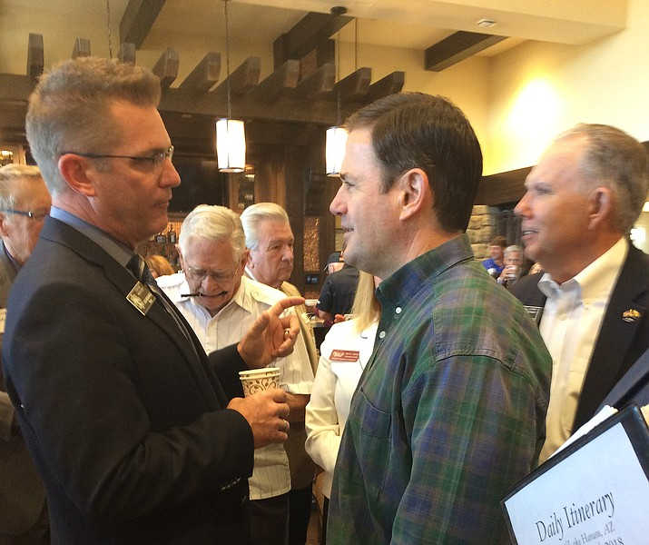 Prescott Mayor Greg Mengarelli chats with Republican Gov. Doug Ducey at a Prescott Chamber of Commerce event at The Finn Restaurant in the Touchmark development attended by about 100 area business and civic leaders on Friday, June 22, 2018. Ducey officially announced his reelection plans, thanking his supporters for the confidence they had in him four years ago and moving forward. (Nanci Hutson/Courier)