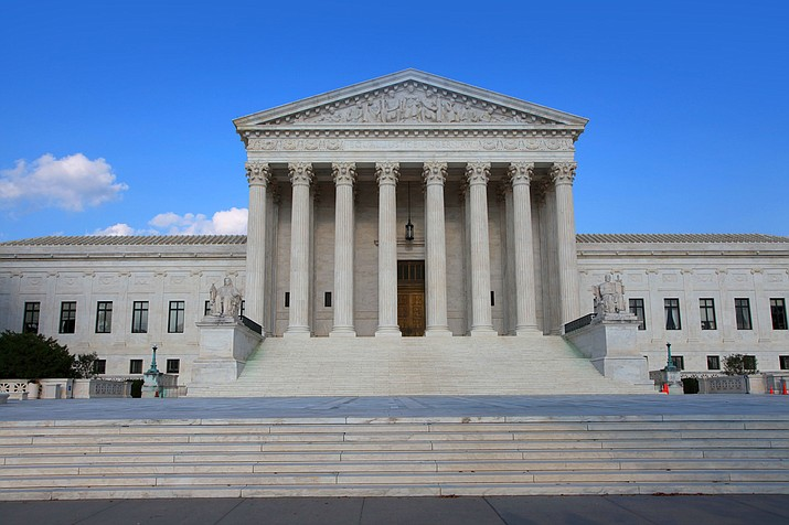 In a 5-4 decision Friday, The Supreme Court says police generally need a search warrant if they want to track criminal suspects' movements by collecting information about where they've used their cellphones. (Adobe File Photo)