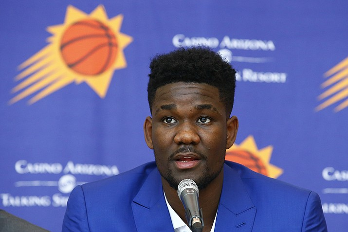 Phoenix Suns' Deandre Ayton answers a question during a news conference Friday, June 22, 2018, in Phoenix, as the team introduces its new players a day after the NBA Draft. (Ross D. Franklin/AP)