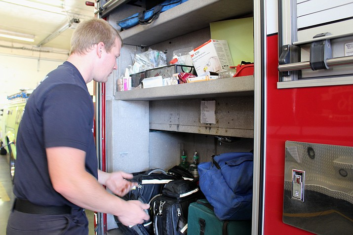 Ethan Atkins, a firefighter with the Kingman Fire Department is talking about the different equipment used by the EMTs and paramedics. Atkins himself is going through the educational training to become a certified paramedic. (Photo by Vanessa Espinoza/Daily Miner)