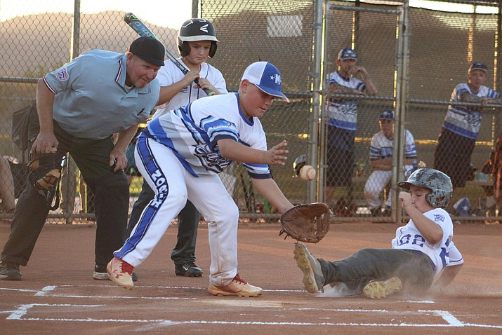 Austin Branch scores the lone run of the game for Kingman South Thursday night at Southside Park.