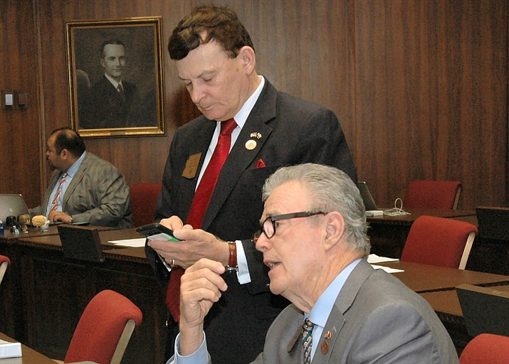 Rep. David Stringer (standing) and seatmate Noel Campbell during this year's legislative session. (Capitol Media Services photo by Howard Fischer)
