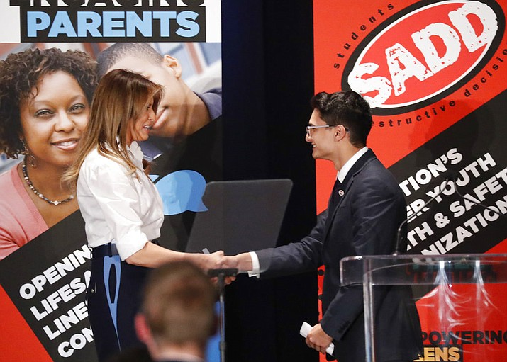 First lady Melania Trump, left, is introduced by Dylan Mullins, right, from New Jersey and the SADD National Student of the year, before speaking to students at the annual conference of SADD: Students Against Destructive Decisions, in Tysons, Va., Sunday, June 24, 2018. (AP Photo/Pablo Martinez Monsivais)