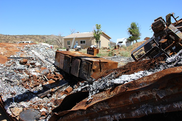 On the outskirts of Mayer sits the remains of a semitrailer that was consumed during the Goodwin Fire. In it was about $40,000 worth of equipment. The home in the background is newly built for the owner, who lost his home and the trailer during the catastrophic blaze.