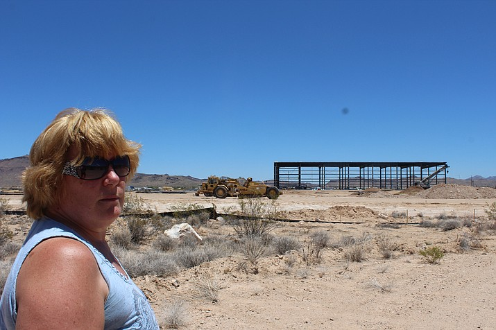 Lia Mitchell points to construction of Scot Industries' new plant in Golden Valley from her backyard on Rancho Road. (Photo by Hubble Ray Smith/Daily Miner)