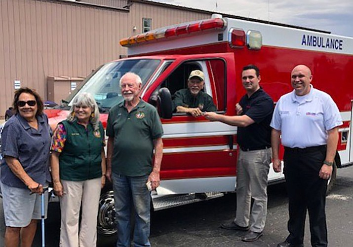 Left to right: Gloria Grimditch, Caborca Treasurer; Susan Jones, Caborca Chair; Cecil LaVance, Caborca Director; Bob Greninger, accepting ambulance keys from Peter Como, LifeLine Operations Manager; and Scott Keilman, LifeLine Administrative Supervisor. (Bob Greninger/Courtesy)