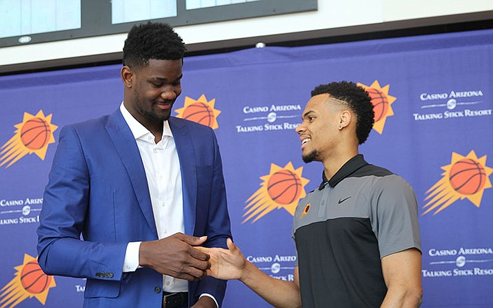 The Phoenix Suns' first pick, Deandre Ayton, and 31st pick, Elie Okobo, talk after the Suns press conference. (Photo by Margaret Naczek/Cronkite News)
