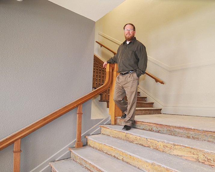 Superintendent Joe Howard walks down the main staircase earlier this year at the former Washington Traditional School that was transformed into the Prescott Unified School District offices. (Les Stukenberg/Courier)