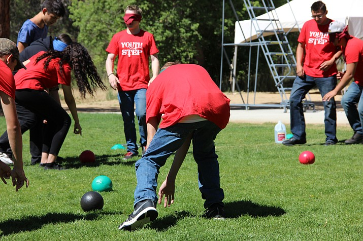 Juvenile probationers participating in Youth STEP play a team-building game Tuesday morning, June 19, at Chapel Rock Camp and Conference Center in Prescott.