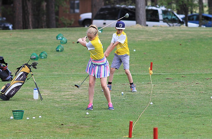 Young golfers work on their golfing skills at the driving range in June 2017.
