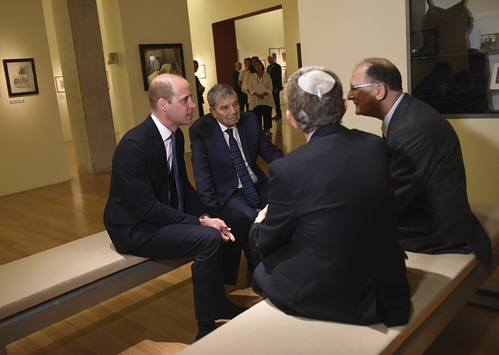 Britain's Prince William, left, speaks with Holocaust survivors during a tour of the Yad Vashem Holocaust Memorial, in Jerusalem, Tuesday, June 26, 2018. (Debbie Hill/Pool Photo via AP)